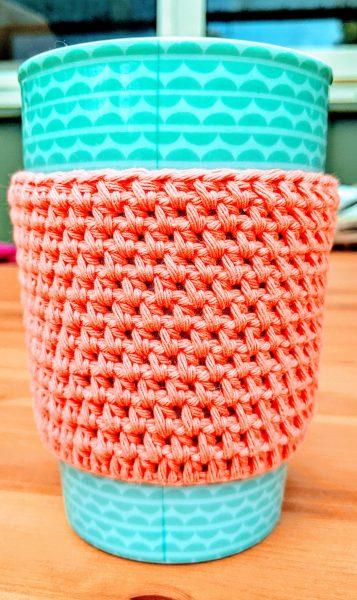 green cup in crochet cup cozy