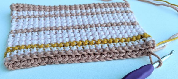 how to crochet thick potholder with stripes. How to carry yarn and change colour.