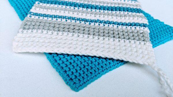 Crochet thermal stitch potholder with stripes.