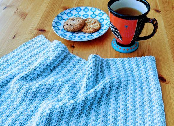 crochet tea towel on table