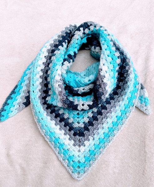 crochet triangle shawl in blue