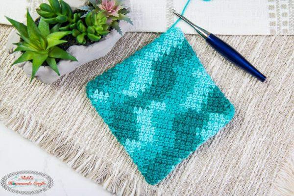 green and blue crochet potholder