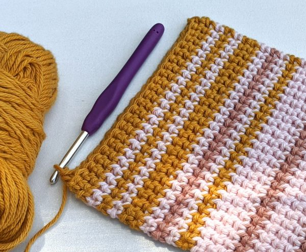 potholder with stripes with crochet hook