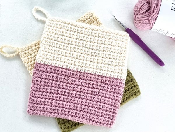two potholders in green, white and pick colours