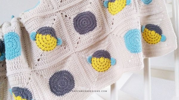 granny square bumble bee crochet baby blanket in yellow, blue and white