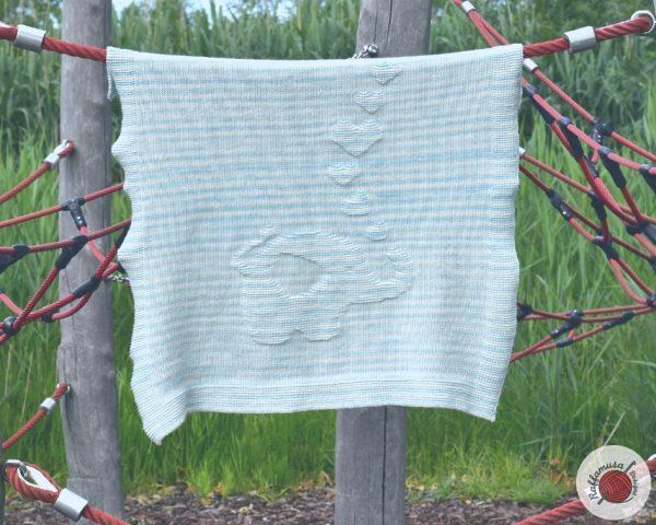 crochet elephant baby blanket hanging on the line