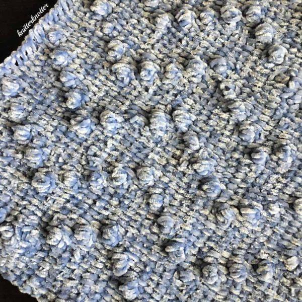 velvet silver blue textured crochet blanket close up