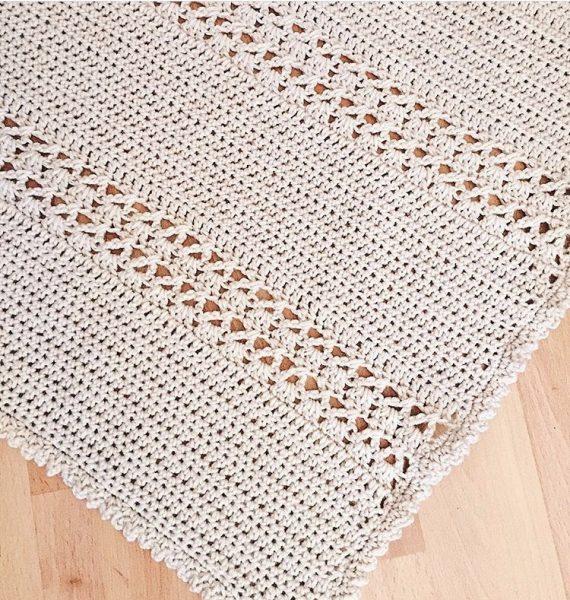 lacy crochet blanket on the floor