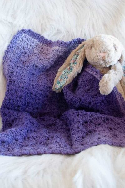 purple ombre coloured blanket with a bunny toy