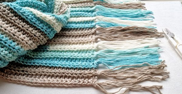 crochet scarf with fringe and scissors
