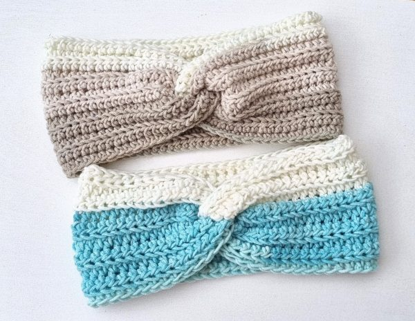 two crocheted headbands with a twist in beige and blue