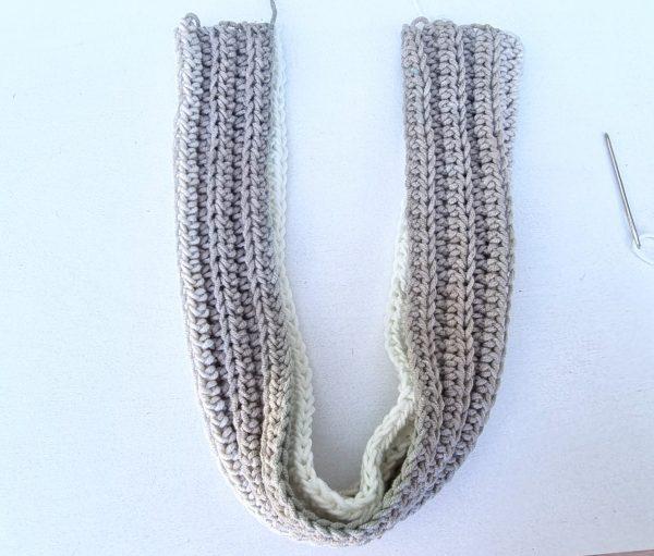 crocheted headband folded in half in U-shape